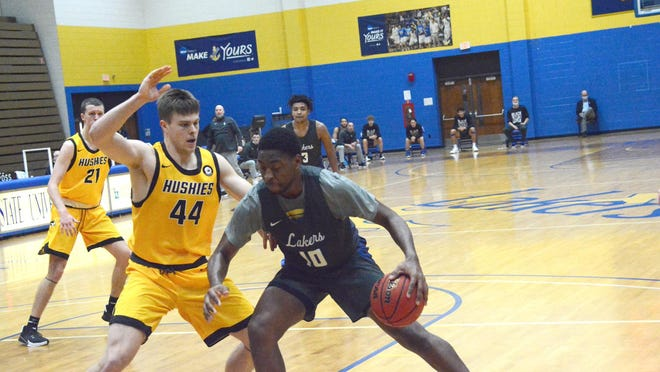 Lake Superior State's Kemon Bassett (10) works in the post against Michigan Tech during a home game this season. Bassett was named the GLIAC North Division Player of the Week.