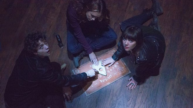 """This photo provided by Universal Pictures shows, from left, Douglas Smith, as Pete, Olivia Cooke, as Laine, and Ana Coto, as Sarah, in the film, """"Ouija."""""""
