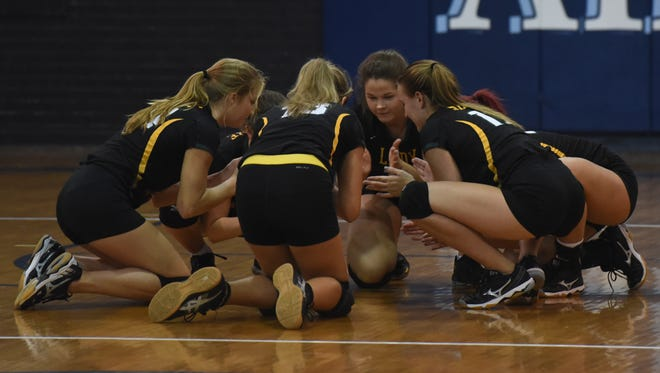 Captain Shreve cheer before their game against Byrd at the Volleyball jamboree at Airline High School.