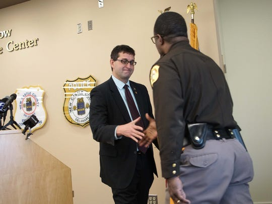 New Castle County Executive Matt Meyer shakes hands with Vaughn Bond after announcing him as the new police chief for the New Castle County Police Department earlier this year.