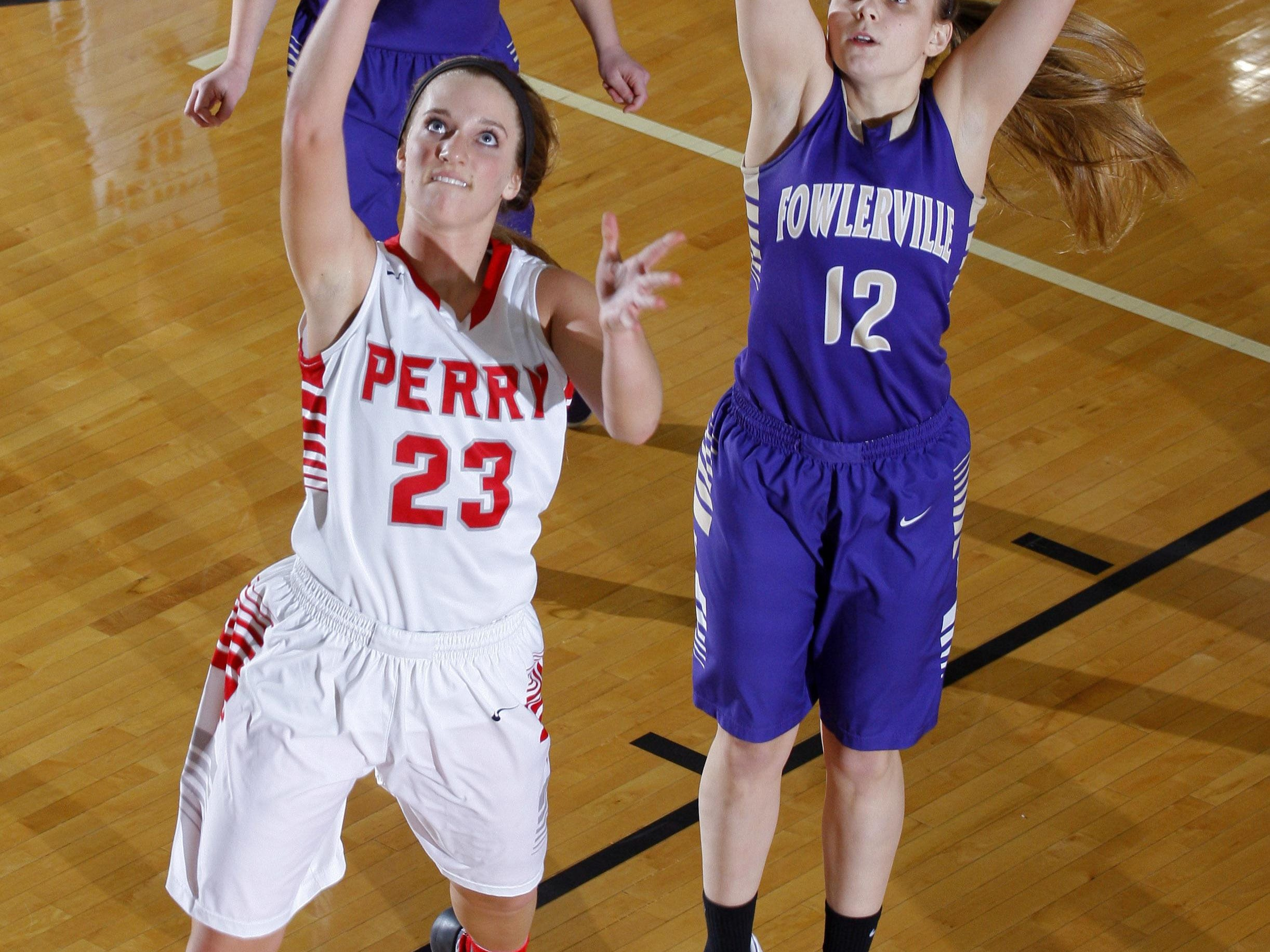 Perry's Kelsey Finch (23) puts up a fast-break layup in front of Fowlerville's Taylor Petterson (12) Wednesday at Williamston High School. Perry won 57-46.