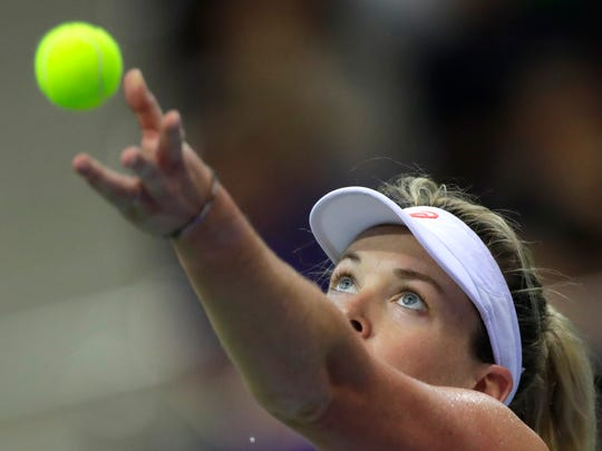 CoCo Vandeweghe of the United States serves against Aliaksandra Sasnovich of Belarus during the Fed Cup final match between Belarus and USA, in Minsk, Belarus, Saturday, Nov. 11, 2017. (AP Photo/Sergei Grits)