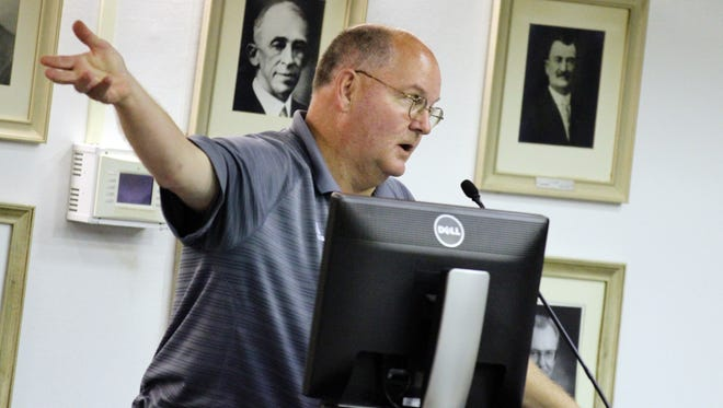 Ken Roebuck addresses the Lafayette Parish School Board at a 2014 meeting. Roebuck has resigned as the principal of Carencro High