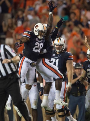 Auburn defensive back Tray Matthews (28) celebrates after intercepting a pass during the NCAA football game between Auburn and Mississippi State on Saturday, Sept. 30, 2017 in Auburn, Ala.