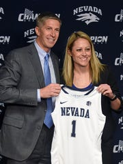 Amanda Levens, right, with AD Doug Knuth was hired as Nevada's new basketball coach in March.