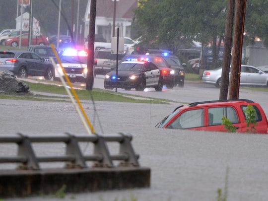 Police block Industrial Highway in Springettsbury Township where several feet of water flooded the roadway, Monday July 17, 2017. John A. Pavoncello photo