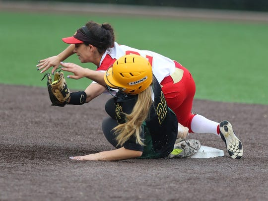 North Hunterdon vs. Mount Olive softball in the NJSIAA Group IV semifinals. North Hunterdon #22 Amanda Brogan safe at second as Mount Olive #2 Isabella Salafia brings the ball down for the tag on Thursday May 31, 2018.
