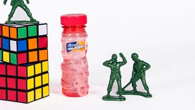 This undated file photo provided by the National Toy Hall of Fame shows bubbles, little green army men and the Rubik's Cube which were inducted as new additions to the National Toy Hall of Fame. The toys enter the Rochester museum after being selected by a panel of expert judges from among a dozen finalists.