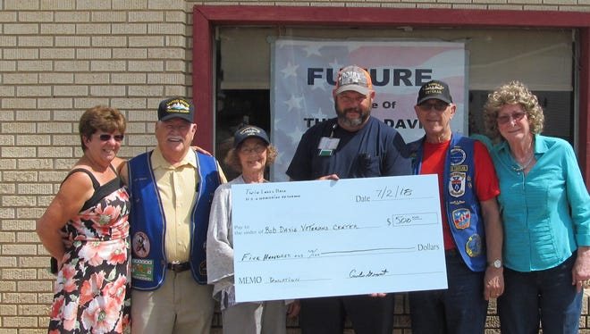 The Twin Lakes Base, U.S. Submarine Veterans, Inc., (TLB USSVI) recently donated $500 to the Bob Davis Veterans Center. Pictured are (from left): Joanna Baxter Ferris, center secretary/treasurer; Tom Hanby, treasurer of the TLB; Anita Hanby; Mike Davenport, incoming commander of the TLB; Curtis Grant, outgoing commander of the TLB; and Priscilla Grant, associate member of the TLB.