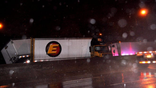 A semi jack-knifed on I-75 south near the Western Hills viaduct Monday, April 14, 2014.