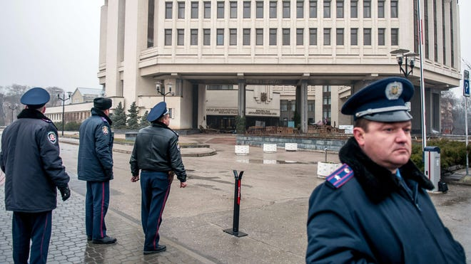 Police officers guard the parliament building in Simferopol on Feb. 27.
