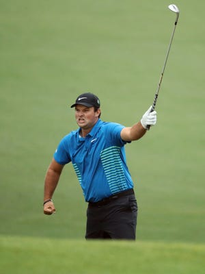 Patrick Reed celebrates his eagle chip on No. 15 during the third round of the Masters on Saturday. Reed holds a three-stroke lead over Rory McIlroy heading into the final round.
