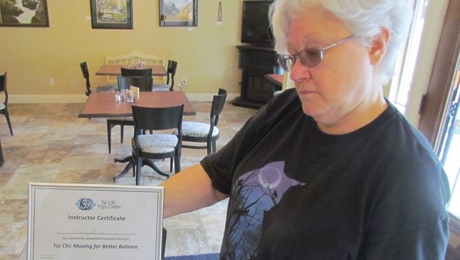 Wendy Stone with her recently earned Instructor Certificate for Tai Chi.