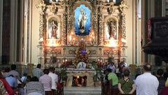 Hundreds of Cubans attend a morning Mass in a Catholic