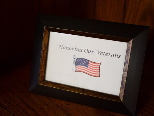 A display honoring veterans at Prestige Senior Living Orchard Heights in West Salem in 2014. Veterans Day is Nov. 11.