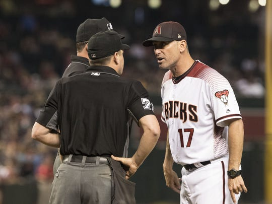 Torey Lovullo yells at Sam Holbrook (34) and D.J. Reyburn