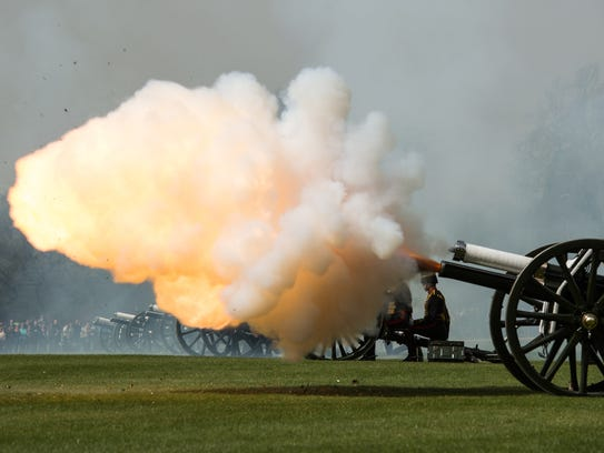 A gun fires during a royal salute to mark the 90th