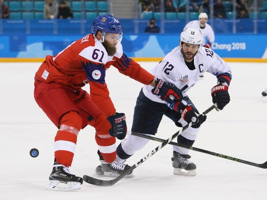 Czech Republic defenseman Adam Polasek (61) plays the puck against United States forward Brian Gionta (12) in the first period of the men's ice hockey quarterfinals during the Pyeongchang 2018 Olympic Winter Games at Gangneung Hockey Centre  on Feb. 21, 2018.