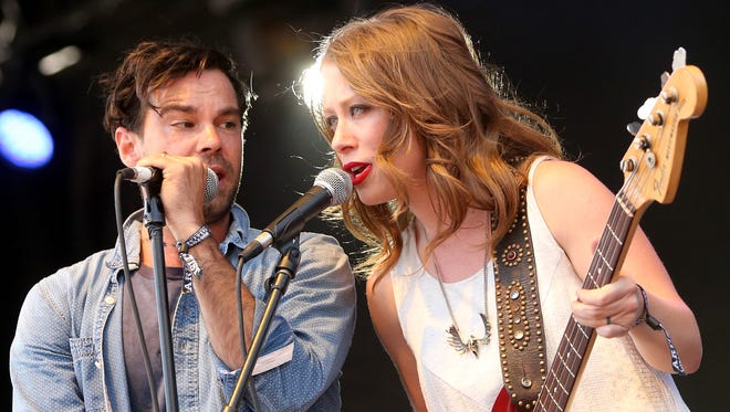 Zach Williams and Kanene Donehey Pipkin of the Lone Bellow perform onstage during Boston Calling Music Festival