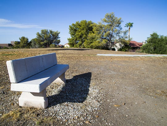 An abandoned bench remains near the 11th hole at the