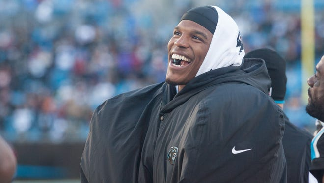Carolina Panthers quarterback Cam Newton (1) laughs on the sidelines in the fourth quarter against the Washington Redskins at Bank of America Stadium.