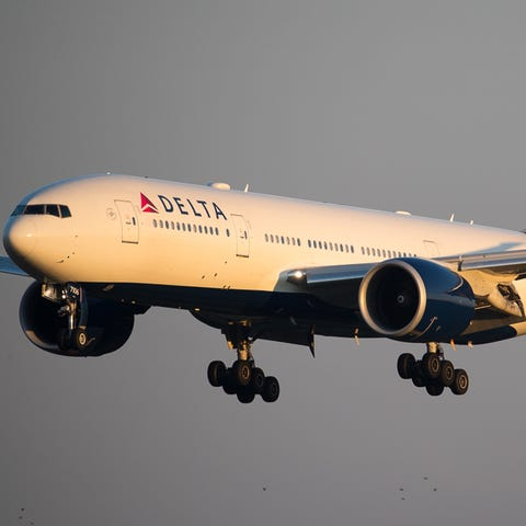 A Delta Air Lines Boeing 777 lands at...