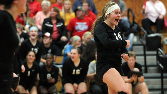 Lone Tree's Morgyn Edwards celebrates a point during the Lions' game against Highlan in Lone Tree on Tuesday, Oct. 13, 2015.