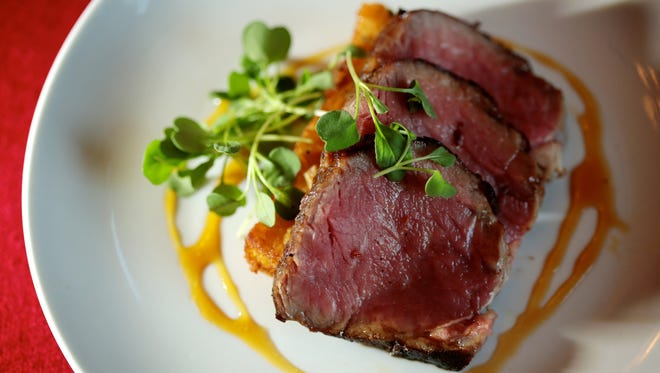 Fourth course, Sirloin with bonito panisse, micro arugula and truffle soy syrup, is served during the Detroit Free Press Top 10 Takeover dinner series at Vertical Detroit on Tuesday, September 20, 2016, in Detroit, MI.