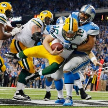 Detroit Lions defensive tackle Ndamukong Suh (90) sacks Green Bay Packers quarterback Matt Flynn for a safety during their 2013 game in Detroit.