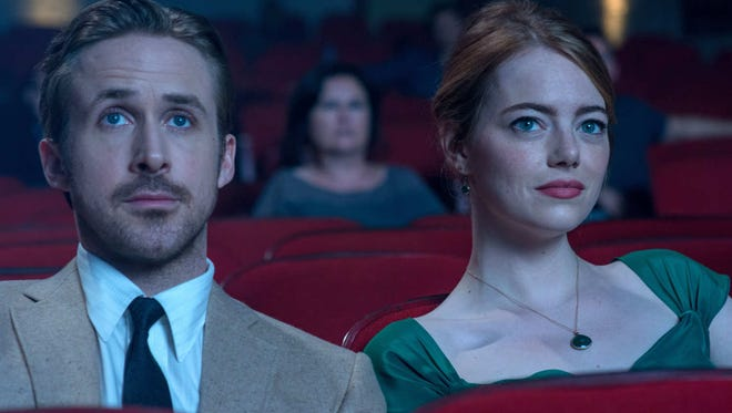 """Academy Award nominees Ryan Gosling and Emma Stone enjoy a date at -- where else? -- the movies in """"La La Land"""""""