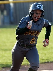 Gallatin High freshman Makayla Wright rounds third base on her way to scoring a run during the four-run third inning.