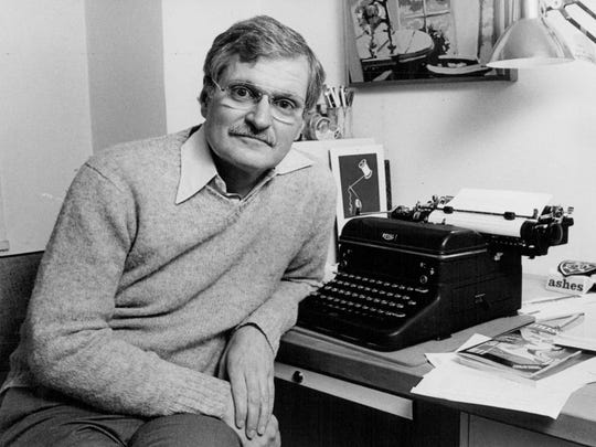 John Ashbery, a poet and author, sits in his office