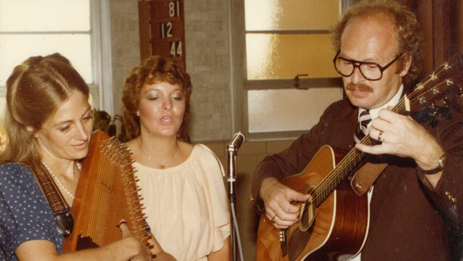 Ann Schmid plays the autoharp and Will Schmid plays guitar at the wedding of Jim and Denice Stingl in 1981. Jim's sister, Claire Sardina, joined the Schmids in singing several songs during the service. Will and Ann accepted an invitation to play at the wedding because Will had inadvertently introduced Jim to Denice by mixing his banjo class with her guitar class at UWM in 1979.