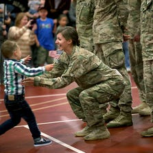 Cooper Waldvogel, 3, runs to hug his mother Kathryn Waldvogel after her return from Afghanistan on Sept. 16 in Inver Grove Heights, Minn.