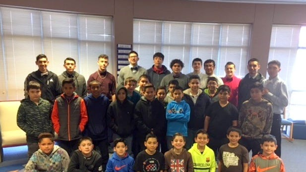 """Integrity is the """"Word of the Month"""" for February at Ruben S. Torres Elementary School in Deming. The Deming High School Wildcat varsity boys' basketball team was invited to meet with fifth-grade boys at the school on Friday, Feb. 3, to discuss what it takes to be a Wildcat and how important it is to have integrity to succeed in the classroom and on the basketball court."""
