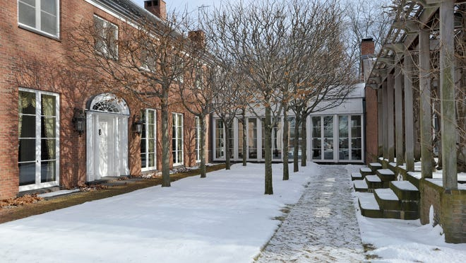 The courtyard of the former home of ex-North Salem Supervisor Paul Greenwood at 16 Wheeler Road in North Salem. The home was auctioned Thursday to repay clients of his investment business, who lost money in an investment fraud.