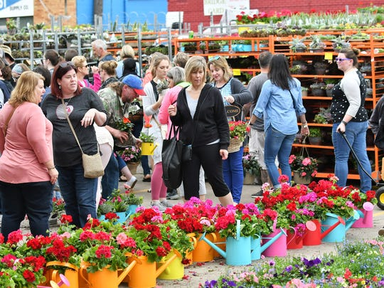 People peruse the plants at Eastern Market.