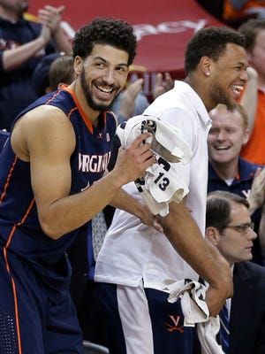 Virginia's Anthony Gill, left, has averaged 13.3 points per game since teammate Justin Anderson, right, was sidelined by a broken finger suffered Feb. 7 in a game against Louisville.