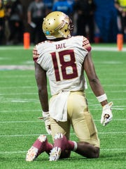 Florida State junior wide receiver Auden Tate dejectedly looks towards the Seminoles sideline after Deondre Francois second interception against the Crimson Tide defense.