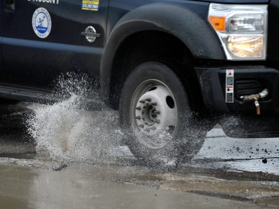 This City of Detroit work truck hits a water-filled