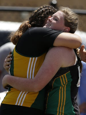 Ashwaubenon's Kris Lindow and Erin Dunning hug after they competed in the Div. 1 shot put during the WIAA state track and field meet at Veterans Memorial Field Sports Complex in La Crosse, Wis., on Saturday, June 4, 2016. Dunning won the event.