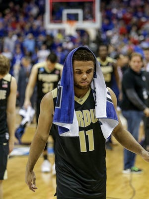 Purdue Boilermakers guard P.J. Thompson (11) makes his way off the court after his team's 98-66 loss to the Kansas Jayhawks in their NCAA Midwest Regional game Thursday, March 23, 2017, evening at the Sprint Center in Kansas City, MO.