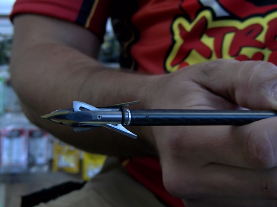 Owner Nathan Reider shows a mechanical broadhead at Xtreme Archery in York