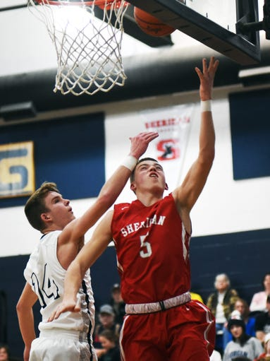 Dylan Emmert goes up for a layup during the second