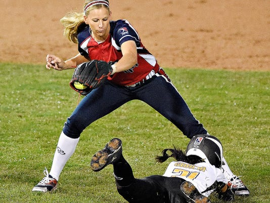 Pennsylvania Rebellion's Samie Garcia, right, safely slides into second as USSSA Pride's Madison Shipman, left, catches the ball during Thursday's game at Santander Stadium in York. The Pride beat the Rebellion, 4-3, in 12 innings.