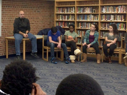 Jeffrey Martinez and Jennifer Sepetys, teachers at Orchard Lake Middle School in West Bloomfield, lead a discussion with eighth-graders about Martin Luther King Jr. and race on Wednesday, Jan. 13, 2016.
