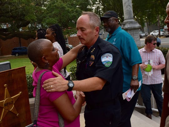 The Rev. Sherri L. Jackson (left) shakes hands with Alexandria Police Chief Loren P. Lampert at a prayer vigil held in July 2016. In reflecting on his time as chief, Lampert thanked the Alexandria community for the support it has shown.