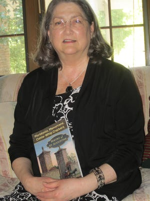 """Ann Browning Masters poses with her new book, """"Floridanos, Menorcans, Cattle-Whip Crackers: Poetry of St. Augustine."""""""