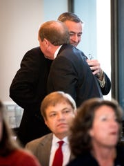 Rep. Glen Casada, rear, R-Franklin, hugs opponent Rep. Mike Carter, R-Ooltewah, after Casada received the majority vote from the House Republican Caucus at the Nashville City Club, Thursday, Nov. 17, 2016, in Nashville, Tenn.