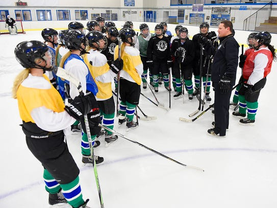 Sartell/Sauk Rapids' hockey Marty Anderson talks to